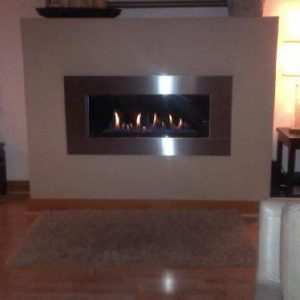 Contemporary gas fireplace with stainless steel front