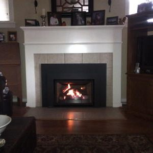 Gas insert with oversized surround