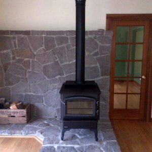 Wood stove with custom brick work