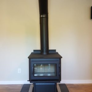 Beautiful wood stove with a hearth pad to match